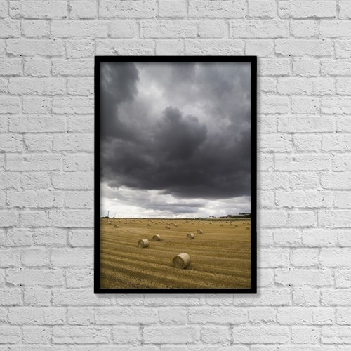 """Printscapes Wall Art: 12"""" x 18"""" Canvas Print With Black Frame - Dark Storm Clouds Over A Field With Hay Bales by John Short"""
