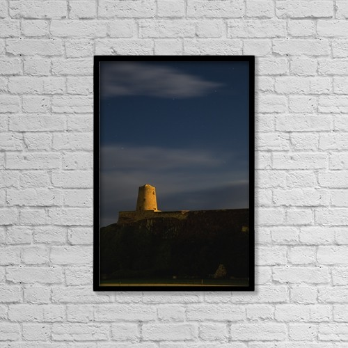 "Printscapes Wall Art: 12"" x 18"" Canvas Print With Black Frame - Sunlight Shining On A Tower Of Bamburgh Castle by John Short"