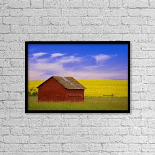 "Printscapes Wall Art: 18"" x 12"" Canvas Print With Black Frame - A Red Farm Building Against A Canola Field by Carson Ganci"