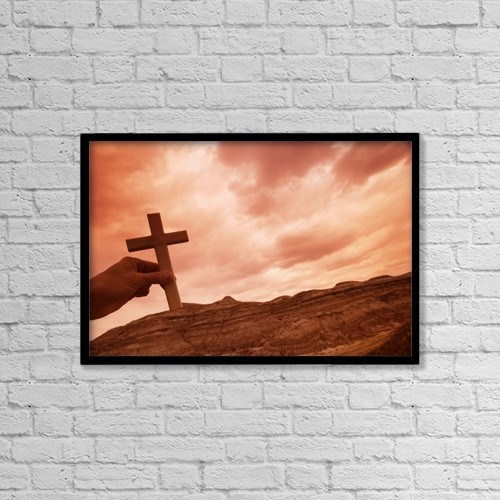 "Printscapes Wall Art: 18"" x 12"" Canvas Print With Black Frame - Hand Holding A Cross by Don Hammond"