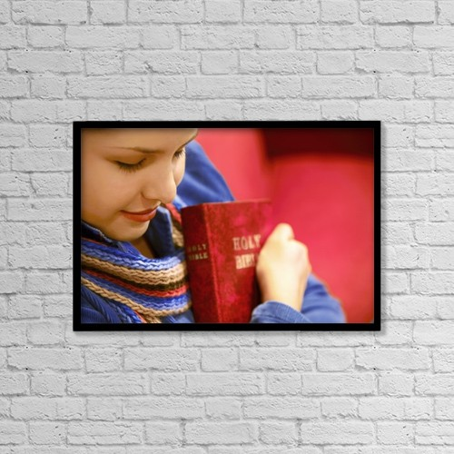 """Printscapes Wall Art: 18"""" x 12"""" Canvas Print With Black Frame - Teen Holds Bible And Prays by Don Hammond"""