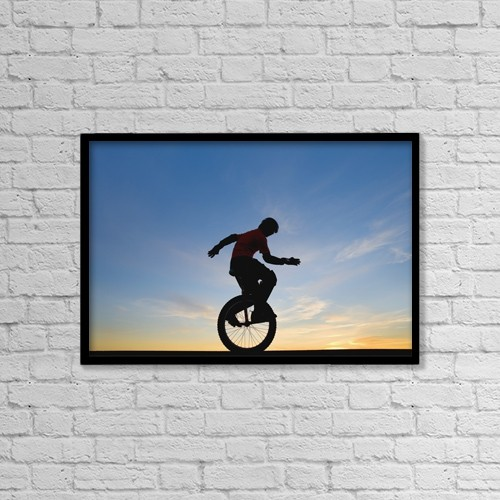 """Printscapes Wall Art: 18"""" x 12"""" Canvas Print With Black Frame - Man On Unicycle by Deddeda"""