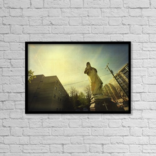 "Printscapes Wall Art: 18"" x 12"" Canvas Print With Black Frame - Religious Statue In The City by Kristy-Anne Glubish"