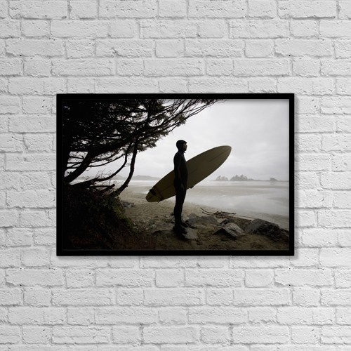 "Printscapes Wall Art: 18"" x 12"" Canvas Print With Black Frame - Surfer Observing Water From The Beach by Deddeda"