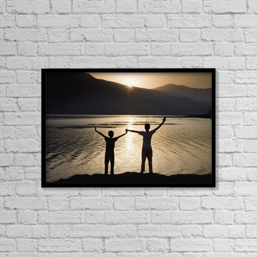 "Printscapes Wall Art: 18"" x 12"" Canvas Print With Black Frame - Children Holding Hands Stretched Up To The Sky by Sean White"