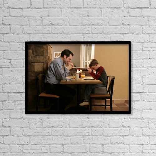 "Printscapes Wall Art: 18"" x 12"" Canvas Print With Black Frame - Father And Son Praying Before Meal by Ron Nickel"
