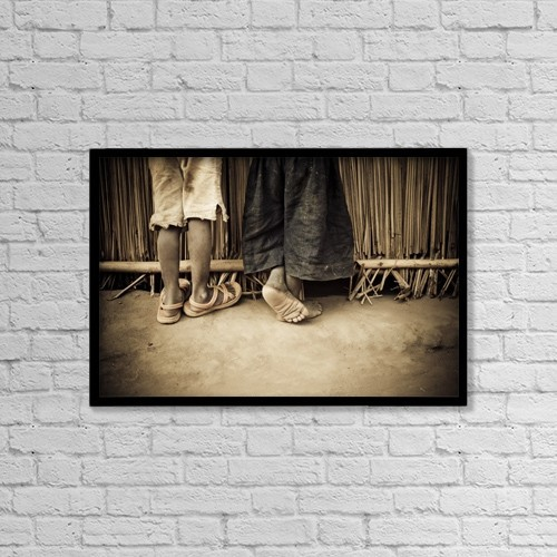 "Printscapes Wall Art: 18"" x 12"" Canvas Print With Black Frame - Close-Up Of Legs; Gulu, Northern Uganda by David DuChemin"