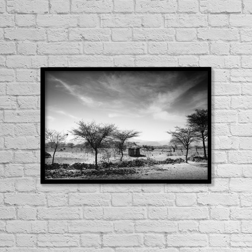 "Printscapes Wall Art: 18"" x 12"" Canvas Print With Black Frame - Stone Hut Set In Grassland Plains by David DuChemin"