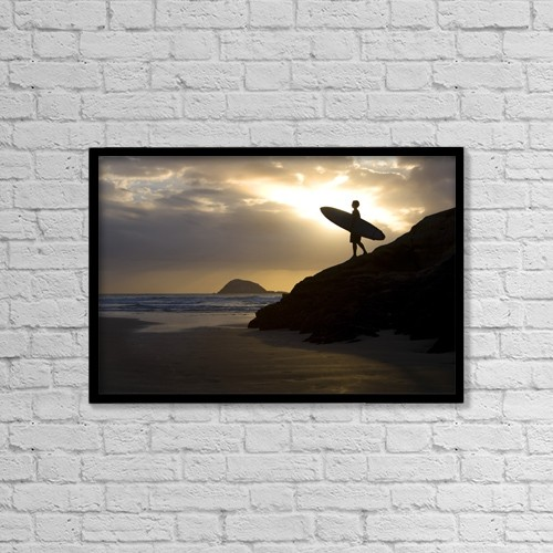 "Printscapes Wall Art: 18"" x 12"" Canvas Print With Black Frame - A Surfer On Muriwai Beach New Zealand by Deddeda"
