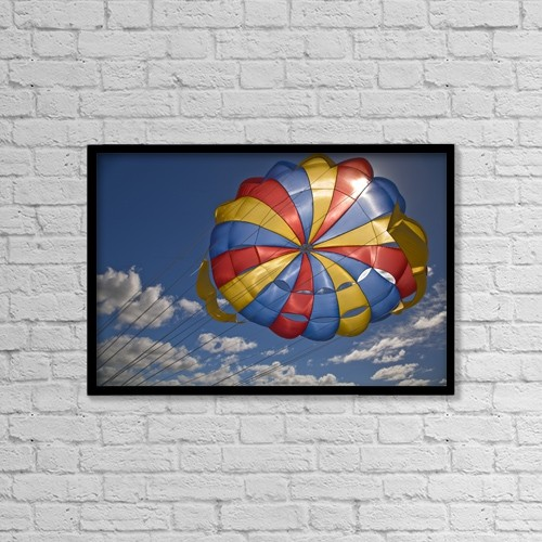 "Printscapes Wall Art: 18"" x 12"" Canvas Print With Black Frame - Parasail Backlit By Sun; Mauritius by Stuart Westmorland"