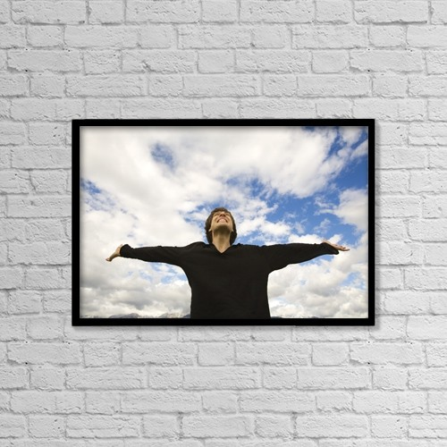 """Printscapes Wall Art: 18"""" x 12"""" Canvas Print With Black Frame - Man With Arms Raised by Chris and Kate Knorr"""