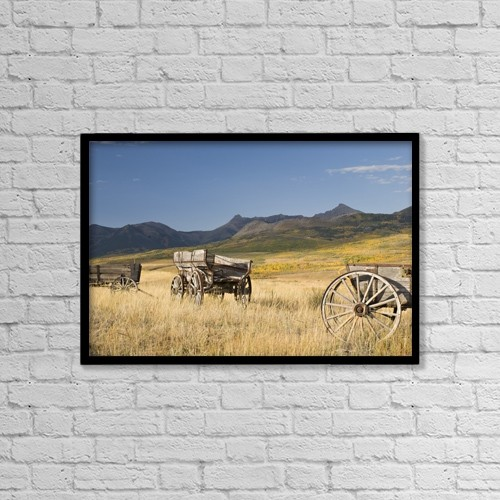 "Printscapes Wall Art: 18"" x 12"" Canvas Print With Black Frame - Old Wagons, Foothills, Alberta, Canada by Philippe Widling"
