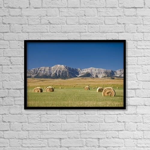 "Printscapes Wall Art: 18"" x 12"" Canvas Print With Black Frame - Field Of Hay Bales, Alberta, Canada by Philippe Widling"