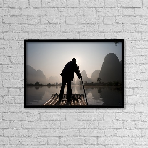 "Printscapes Wall Art: 18"" x 12"" Canvas Print With Black Frame - Man On Raft In Mountain Area by Keith Levit"