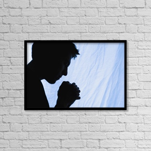 "Printscapes Wall Art: 18"" x 12"" Canvas Print With Black Frame - Silhouette Of A Man Praying by Chris and Kate Knorr"