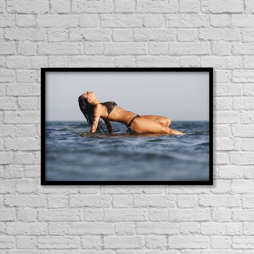 "Printscapes Wall Art: 18"" x 12"" Canvas Print With Black Frame - Woman Lying On The Water by Ben Welsh"