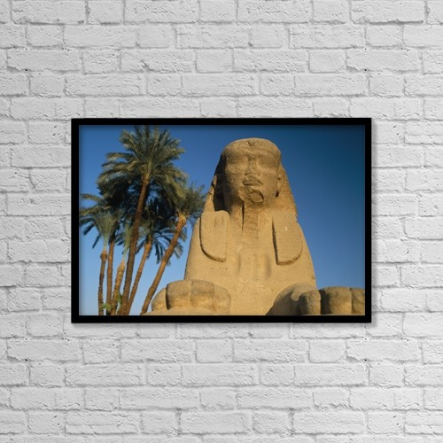 """Printscapes Wall Art: 18"""" x 12"""" Canvas Print With Black Frame - Sphinx Statue In Front Of Date Palms by Ian Cumming"""