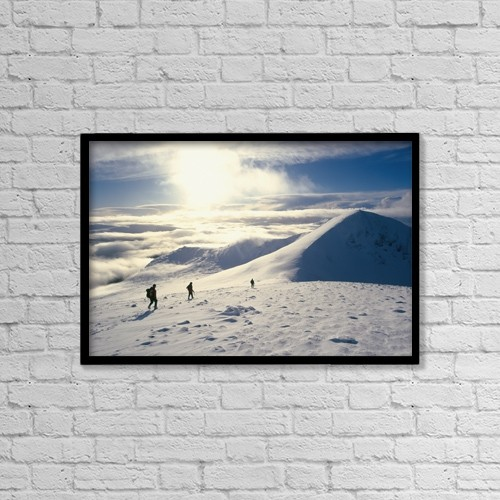 """Printscapes Wall Art: 18"""" x 12"""" Canvas Print With Black Frame - Hikers On A Mountaintop In The Snow by Ian Cumming"""