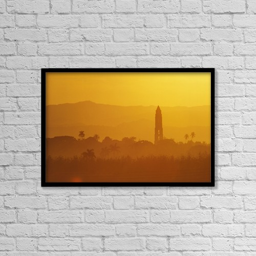 "Printscapes Wall Art: 18"" x 12"" Canvas Print With Black Frame - Tower Silhouetted Amongst Orange Mountains by Ian Cumming"