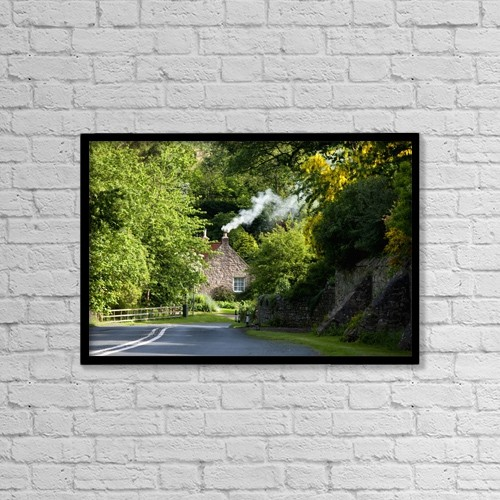 "Printscapes Wall Art: 18"" x 12"" Canvas Print With Black Frame - A Road Surrounded By Trees Leading To A House by John Short"