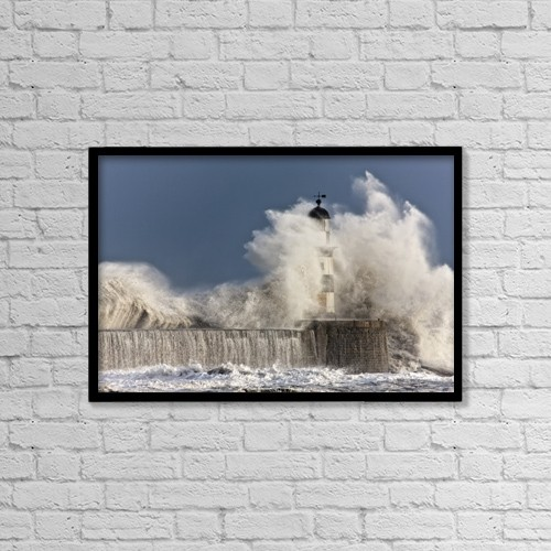 "Printscapes Wall Art: 18"" x 12"" Canvas Print With Black Frame - Waves Crashing Up Against A Lighthouse by John Short"