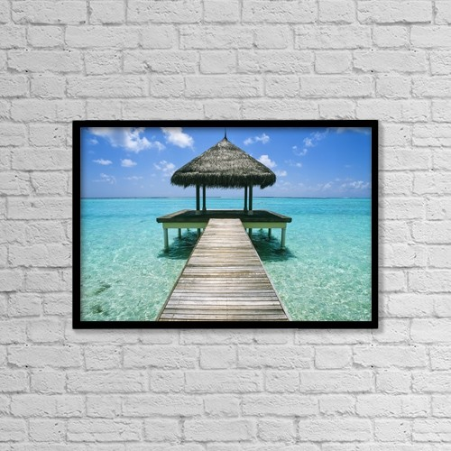 "Printscapes Wall Art: 18"" x 12"" Canvas Print With Black Frame - Grass Hut And Pier by Chris Caldicott"