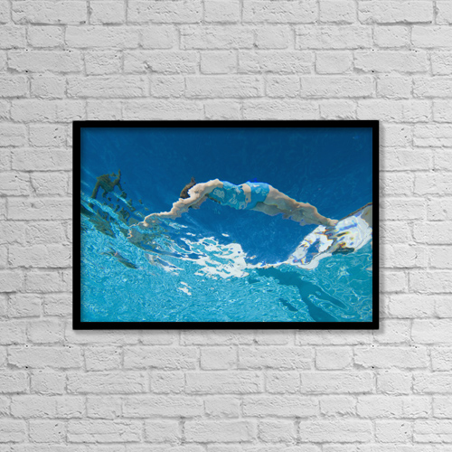 """Printscapes Wall Art: 18"""" x 12"""" Canvas Print With Black Frame - Underwater View Of Woman Diving Into Pool by Ian Cumming"""