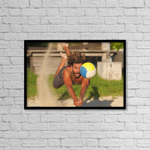 "Printscapes Wall Art: 18"" x 12"" Canvas Print With Black Frame - A Man Diving For A Beach Ball by Ben Welsh"