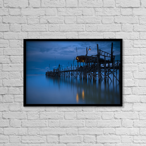 "Printscapes Wall Art: 18"" x 12"" Canvas Print With Black Frame - A Wooden Pier With Lights On It At Night by David DuChemin"