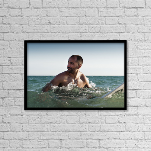 "Printscapes Wall Art: 18"" x 12"" Canvas Print With Black Frame - A Man With His Surfboard In The Water by Ben Welsh"