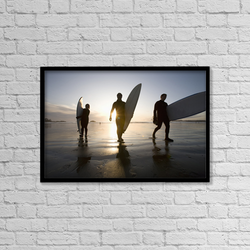 "Printscapes Wall Art: 18"" x 12"" Canvas Print With Black Frame - Silhouette Of Three Surfers Carrying Surfboards by Deddeda"