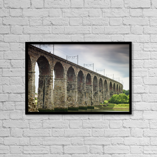 "Printscapes Wall Art: 18"" x 12"" Canvas Print With Black Frame - A Bridge With Arches And Power Lines On Top by John Short"