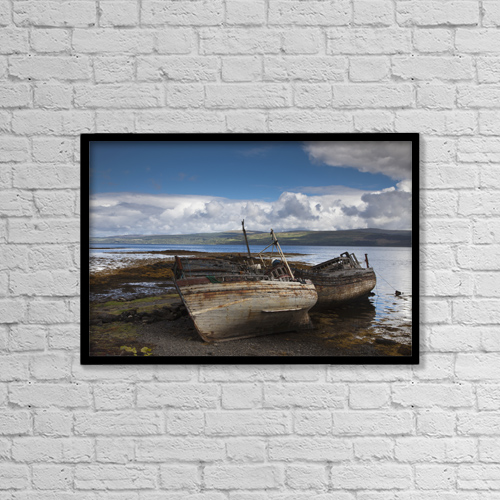 "Printscapes Wall Art: 18"" x 12"" Canvas Print With Black Frame - Weathered Boats Abandoned At The Water's Edge by John Short"