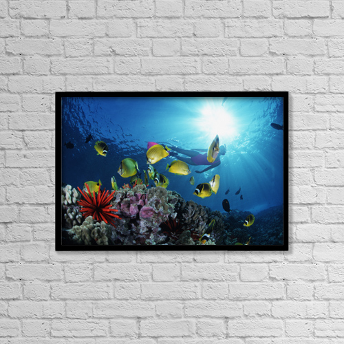 """Printscapes Wall Art: 18"""" x 12"""" Canvas Print With Black Frame - Female Snorkeler Silhouetted With Sunburst by Ed Robinson"""