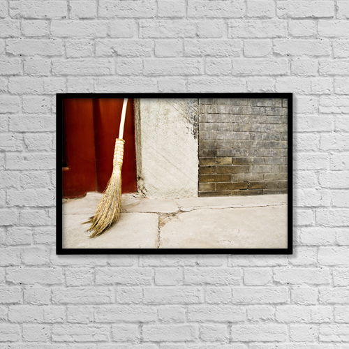 """Printscapes Wall Art: 18"""" x 12"""" Canvas Print With Black Frame - China, Broom Leaning Against Cement Wall by Ray Laskowitz"""