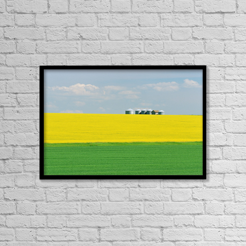 """Printscapes Wall Art: 18"""" x 12"""" Canvas Print With Black Frame - Canola And Graineries, Holland, Manitoba by Mike Grandmaison"""