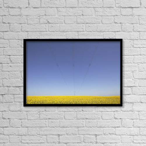 """Printscapes Wall Art: 18"""" x 12"""" Canvas Print With Black Frame - Canola Field And Power Lines, East Of Nanton by Ron Bouwhuis"""