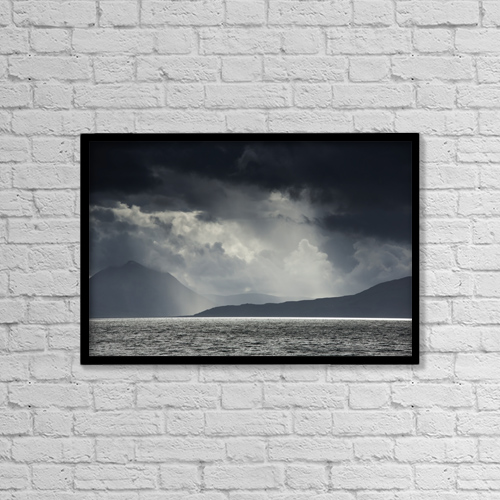 "Printscapes Wall Art: 18"" x 12"" Canvas Print With Black Frame - Sunlight shining through dark storm clouds by John Short"