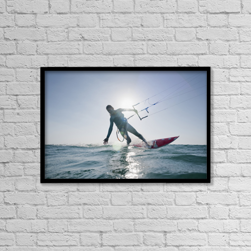 """Printscapes Wall Art: 18"""" x 12"""" Canvas Print With Black Frame - Kitesurfer illuminated by the sunlight by Ben Welsh"""