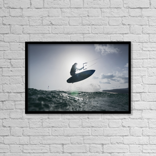 "Printscapes Wall Art: 18"" x 12"" Canvas Print With Black Frame - A kitesurfer on his board in mid-air by Ben Welsh"