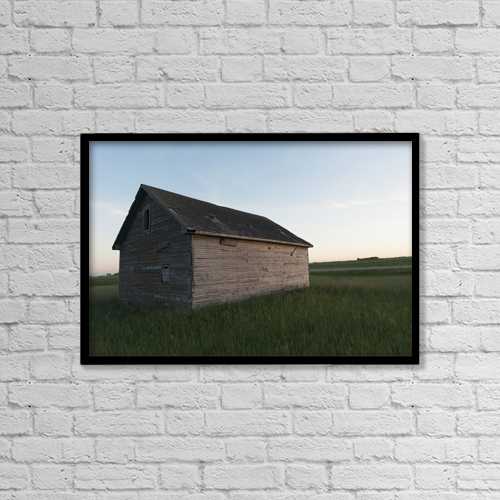 """Printscapes Wall Art: 18"""" x 12"""" Canvas Print With Black Frame - A wooden shed in the middle of a grass field by Keith Levit"""