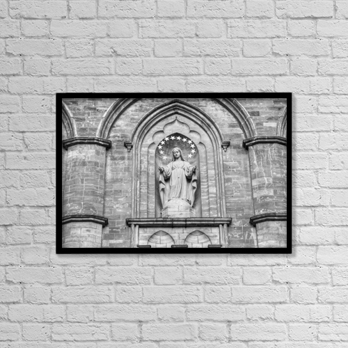 """Printscapes Wall Art: 18"""" x 12"""" Canvas Print With Black Frame - Statue On Facade Of Notre Dame Church by David Chapman"""