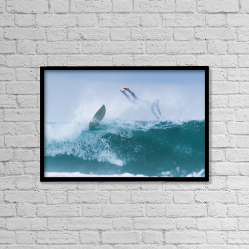 "Printscapes Wall Art: 18"" x 12"" Canvas Print With Black Frame - Surfer diving into water off his surfboard by Ben Welsh"