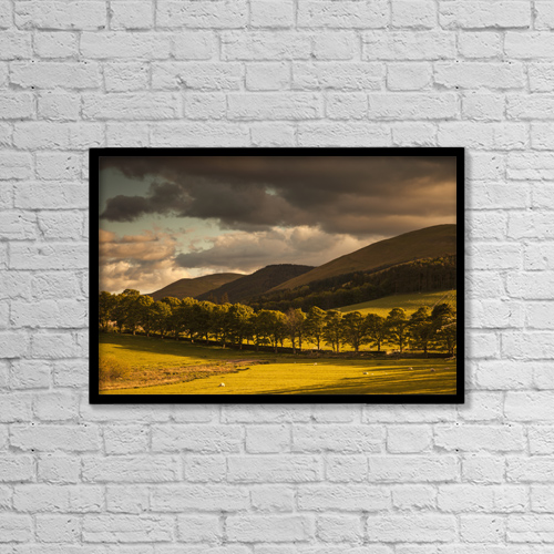 "Printscapes Wall Art: 18"" x 12"" Canvas Print With Black Frame - A golden landscape under a cloudy sky at dusk by John Short"