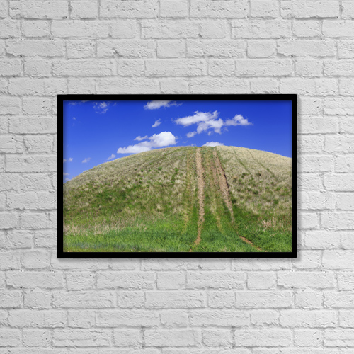 """Printscapes Wall Art: 18"""" x 12"""" Canvas Print With Black Frame - Tire Tracks On A Grassy Hill by Ken Gillespie"""