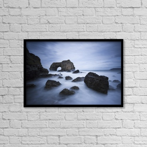 "Printscapes Wall Art: 18"" x 12"" Canvas Print With Black Frame - Natural Rock Arch Over The Sea by Peter McCabe"