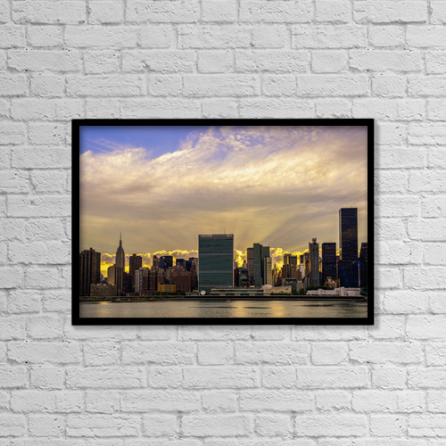 "Printscapes Wall Art: 18"" x 12"" Canvas Print With Black Frame - Sun Setting Behind United Nations by F. M. Kearney"