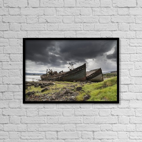 """Printscapes Wall Art: 18"""" x 12"""" Canvas Print With Black Frame - Two Large Boats Abandoned On The Shore by John Short"""