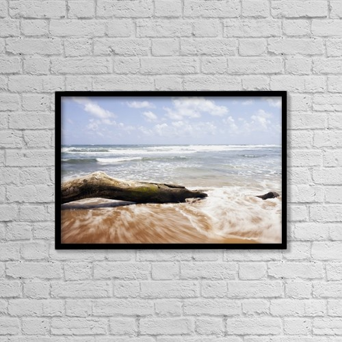 "Printscapes Wall Art: 18"" x 12"" Canvas Print With Black Frame - Driftwood And Rocks At Lydgate Beach Park by Ian Ludwig"