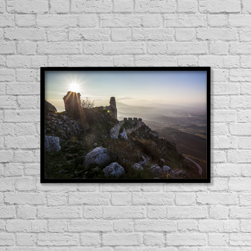 "Printscapes Wall Art: 18"" x 12"" Canvas Print With Black Frame - Ruins Of A Stone Building And Sunburst by Reynold Mainse"